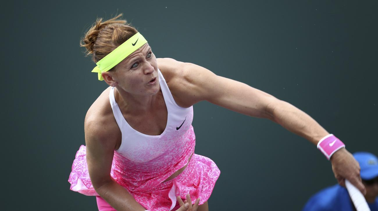 Lucie Safarova, of the Czech Republic, serves the ball to Johanna Larsson, of Sweden, during their match at the Miami Open tennis tournament in Key Biscayne, Fla.,Friday, March 27, 2015.(AP Photo/J Pat Carter)