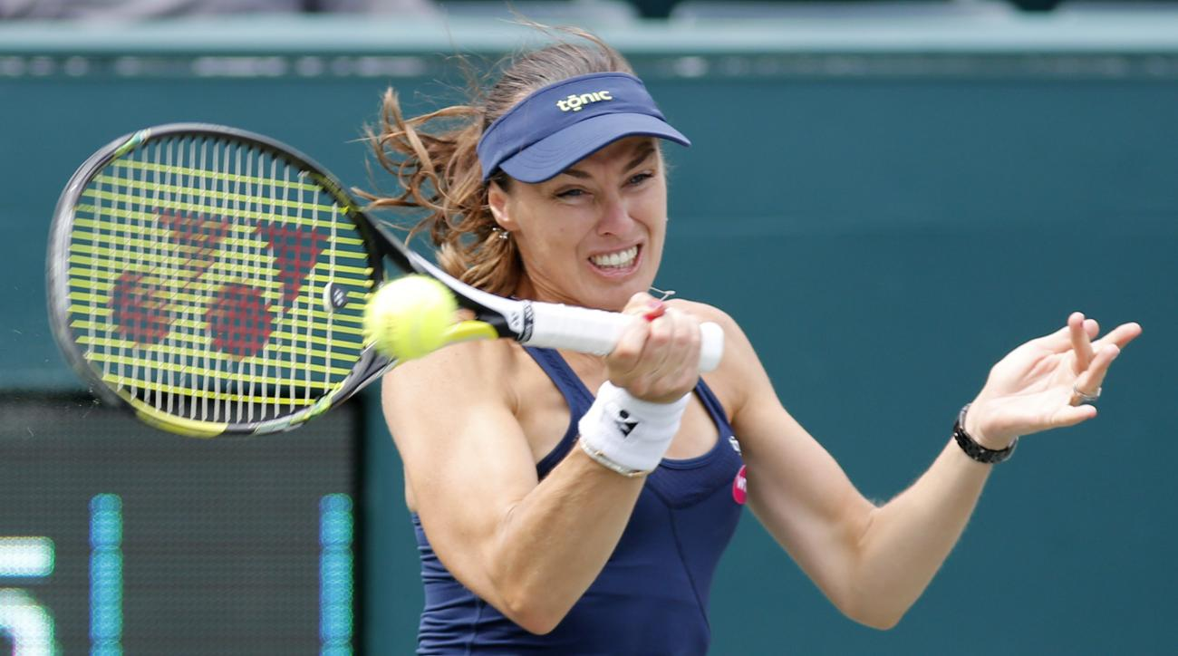 Martina Hingis, of Switzerland, returns to Alla Kudryavtseva and Anastasia Pavlyuchenkova during a doubles final match at the Family Circle Cup tennis tournament Sunday, April 12, 2015, in Charleston, S.C. Sania Mirza and Hingis won 6-0, 6-4. (AP Photo/Mi