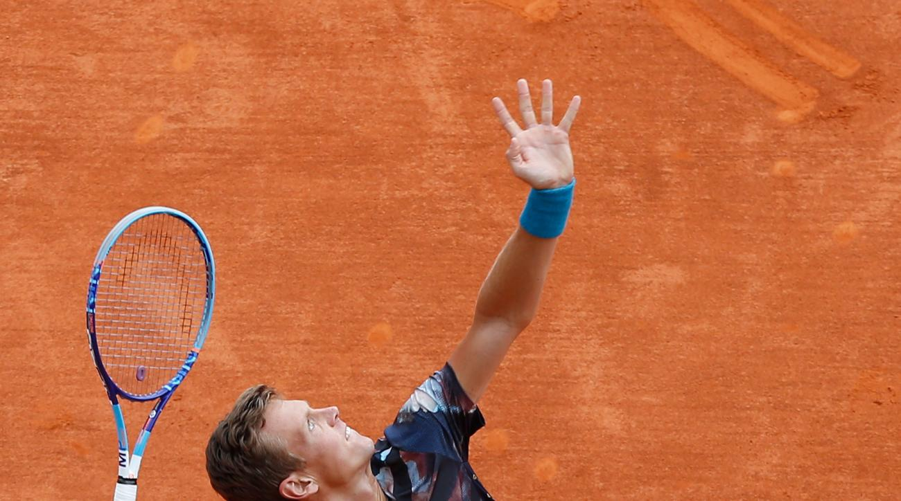 Tomas Berdych of Czech Republic serves the ball to Gael Monfils of France, during their semifinal match of the Monte Carlo Tennis Masters tournament, in Monaco, Saturday, April 18, 2015. (AP Photo/Claude Paris)