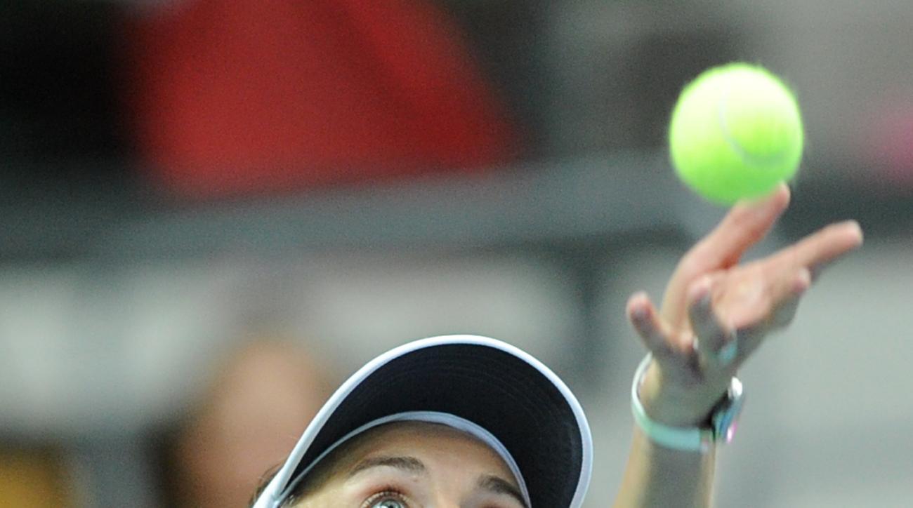 Switzerland's Martina Hingis serves  a  ball  to Poland's Agnieszka Radwanska during their Fed Cup World Group Playoff tennis match between Poland and Switzerland, in Zielona Gora, Poland, Saturday, April 18, 2015.  Five-time Grand Slam champion Martina H