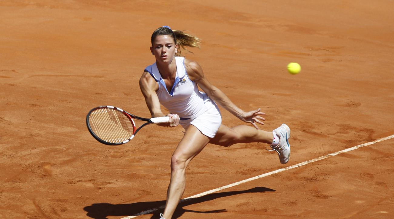 Italy's Camila Giorgi returns the ball to Serena Williams of the United States during a Fed Cup World Group playoff tennis match in Brindisi, Italy, Saturday, April 18, 2015. (AP Photo/Felice Calabro')