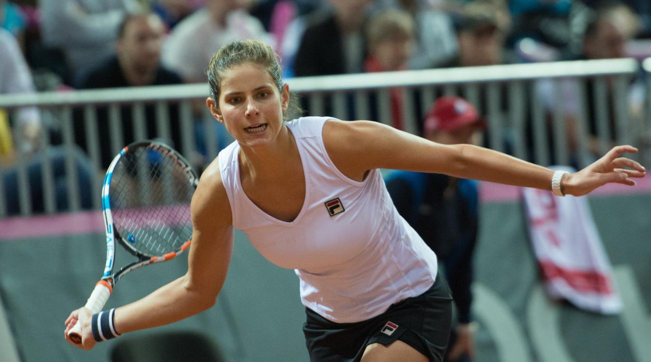 Julia Goerges of Germany returns a shot to  Svetlana Kuznetsova of Russia during their Fed Cup semifinal tennis match in Sochi, Russia, Saturday, April 18, 2015. (AP Photo/Artur Lebedev)