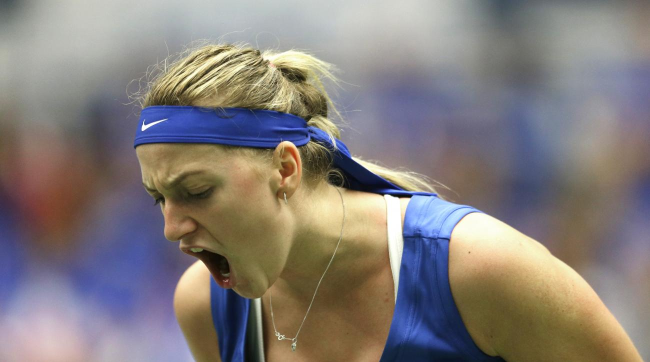 Petra Kvitova from Czech Republic reacts after winning a point against Kristina Mladenovic from France during the Fed Cup tennis semifinal match in Ostrava, Czech Republic, Saturday, April 18, 2015. Kvitova won the match in straight sets and gave Czech Re