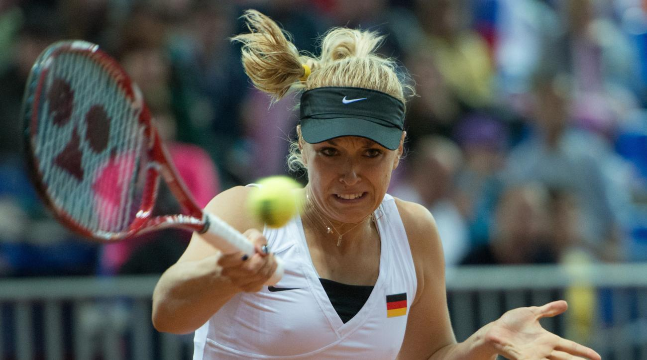Sabine Lisicki of Germany returns a shot to Anastasia Pavlyuchenkova of Russia during their Fed Cup semifinal tennis match in Sochi, Russia, Saturday, April 18, 2015. Russia is on the brink of the Fed Cup final after Anastasia Pavlyuchenkova beat Germany'