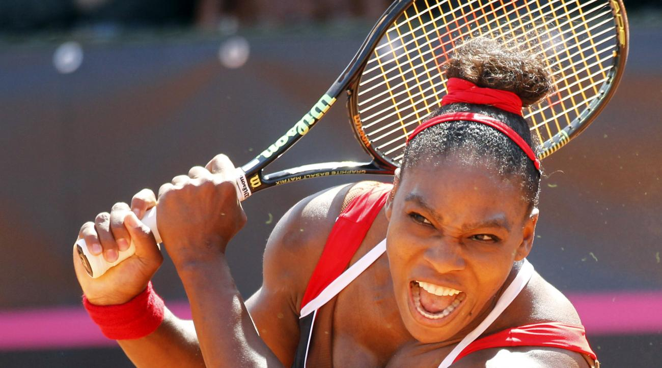 Serena Williams of United States returns the ball to Italy's Sara Errani during a Fed Cup World Group playoff tennis match in Brindisi, Italy, Sunday, April 19, 2015. (AP Photo/Felice Calabro')