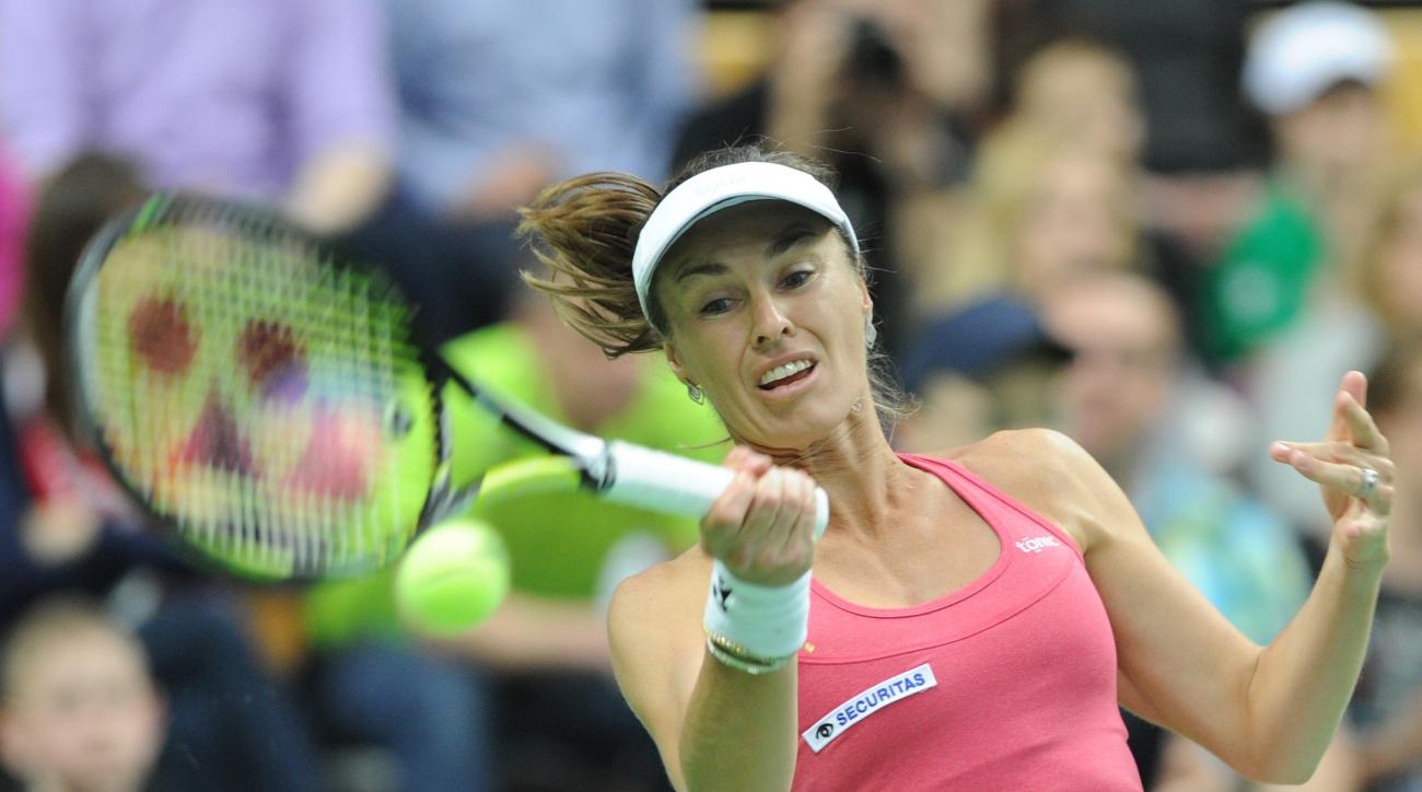 Switzerland's Martina Hingis returns a shot to Poland's Urszula Radwanska during their Fed Cup World Group Playoff tennis match between Poland and Switzerland, in Zielona Gora, Poland, Sunday, April 19, 2015. (AP Photo/Alik Keplicz)