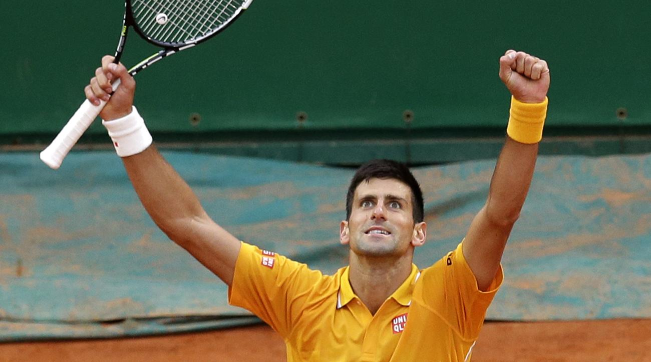 Novak Djokovic of Serbia reacts after defeating Thomas Berdych of Czech Republic in their final match of the Monte Carlo Tennis Masters tournament in Monaco, Sunday, April 19, 2015. (AP Photo/Lionel Cironneau)