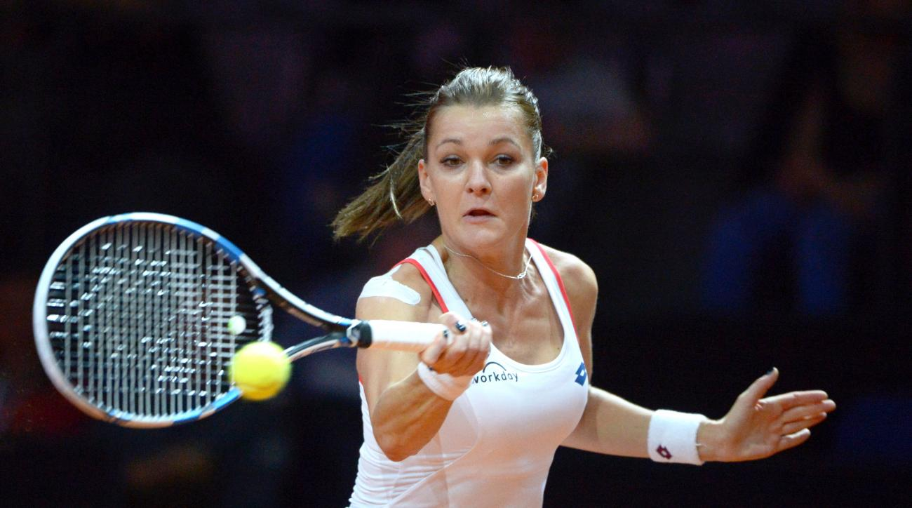 Agnieszka Radwanska of Poland returns the ball to Sara Errani of Italy in the first round of the Porsche Grand Prixtennistournament in Stuttgart, Germany, Wednesday, April 22, 2015. (Marijan Murat/dpa via AP)