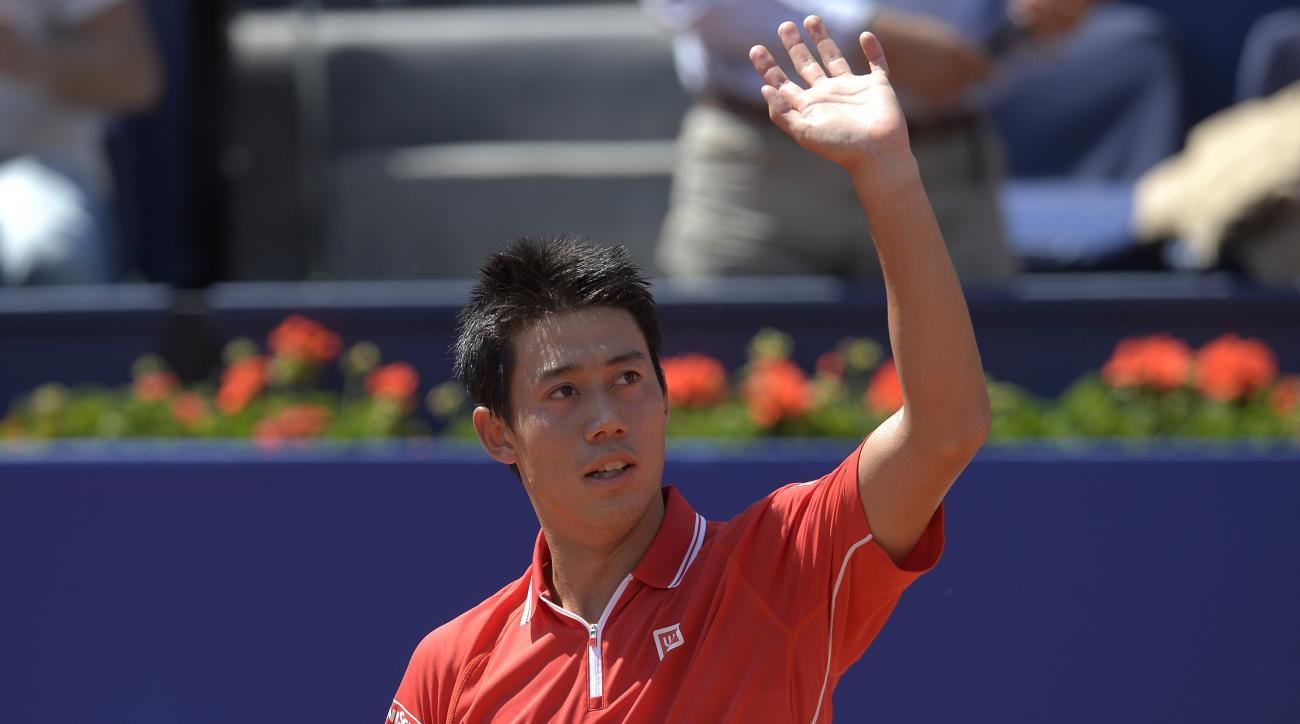 Kei Nishikori of Japan reacts after wining his match against Santiago Giraldo of Colombia, during the Barcelona open tennis tournament in Barcelona, Spain, Thursday, April 23, 2015. (AP Photo/Manu Fernandez)