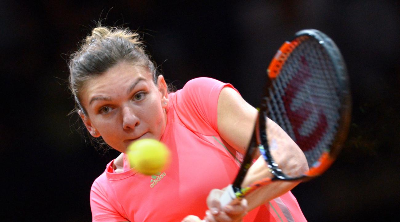 Romania's Simona Halep returns the ball to Italy's Sara Errani during their quarterfinal match at the Porsche Grand Prixtennistournament in Stuttgart, Germany, Friday, April 24, 2015. (Marijan Murat/dpa via AP)