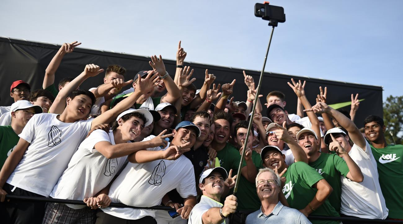 Rory McIlroy uses a selfie stick to take a photo with many of the 54 golfers at the Junior Invitational golf tournament, after speaking to them following the second round at Sage Valley Golf Club in Graniteville, S.C., on Friday, April 24, 2015. (Jon-Mich
