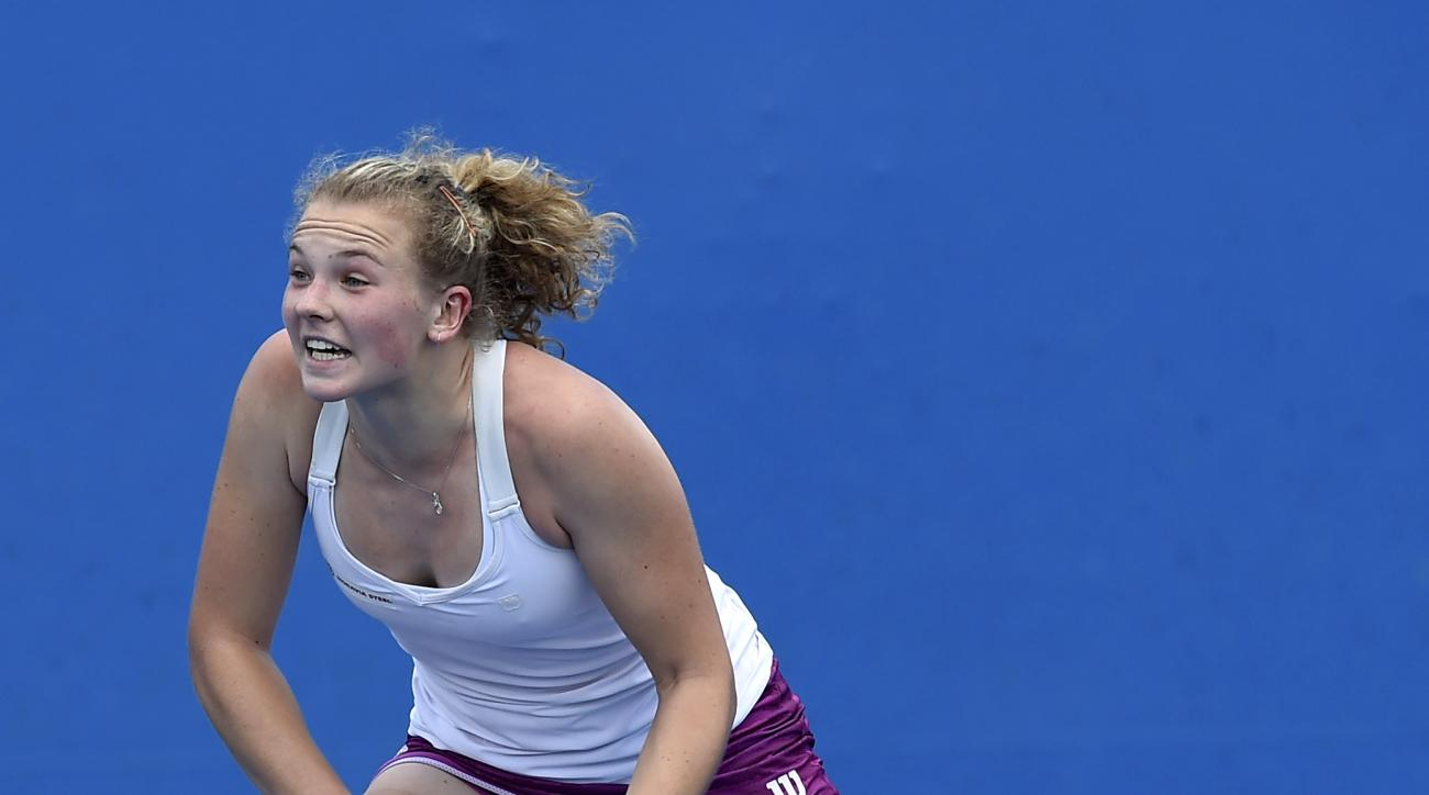Katerina Siniakova of the Czech Republic reacts as she plays Romania's Irina-Camelia Begu during their second round match at the Australian Open tennis championship in Melbourne, Australia, Wednesday, Jan. 21, 2015. (AP Photo/Andy Brownbill)