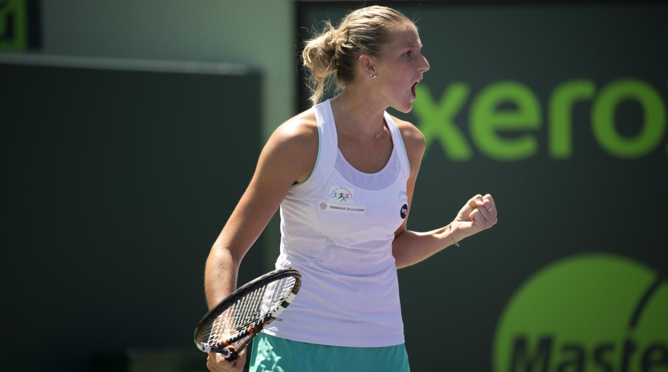 Karolina Pliskova, of the Czech Republic, reacts during her match against Andrea Petkovic, of Germany, at the Miami Open tennis tournament in Key Biscayne, Fla., Tuesday, March 31, 2015. (AP Photo/J Pat Carter)