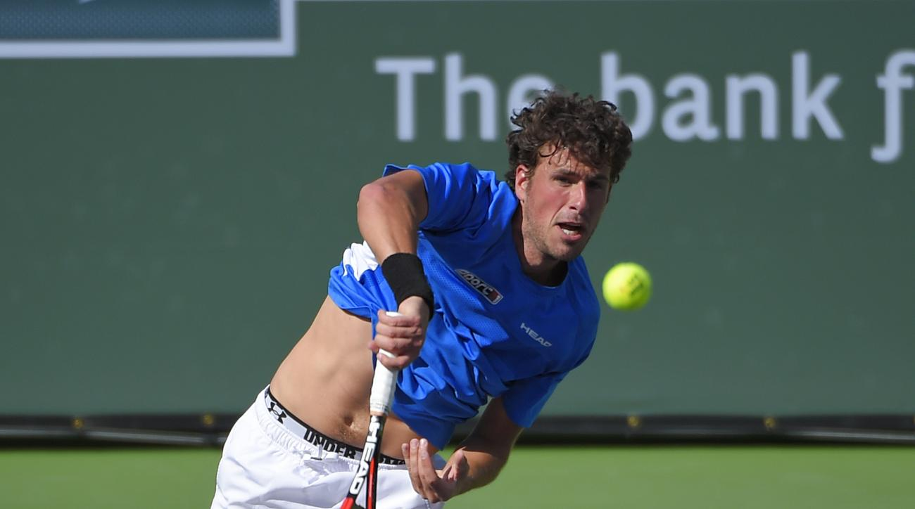 Robin Haase, of the Netherlands, serves to Stanislas Wawrinka, of Switzerland, during their match at the BNP Paribas Open tennis tournament, Sunday, March 15, 2015, in Indian Wells, Calif. (AP Photo/Mark J. Terrill)