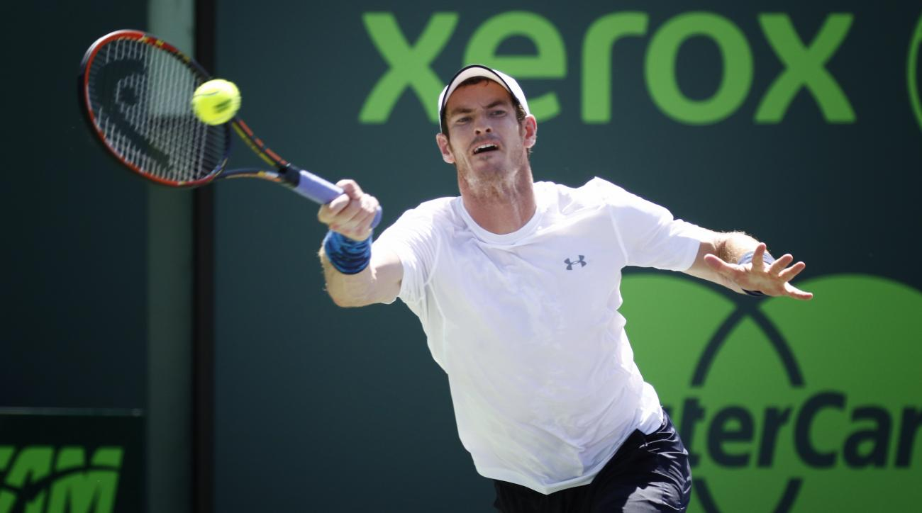 Andy Murray of Great Britain, returns the ball to Novak Djokovic, of Serbia, during the men's final match at the Miami Open tennis tournament in Key Biscayne, Fla., Sunday, April 5, 2015. Djokovic won 7-6 (3), 4-6, 6-0. (AP Photo/J Pat Carter)