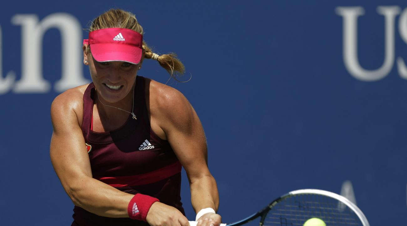 Timea Babos, of Hungary, returns a shot against Lucie Safarova, of the Czech Republic, during the opening round of the 2014 U.S. Open tennis tournament, Monday, Aug. 25, 2014, in New York. (AP Photo/Frank Franklin II)