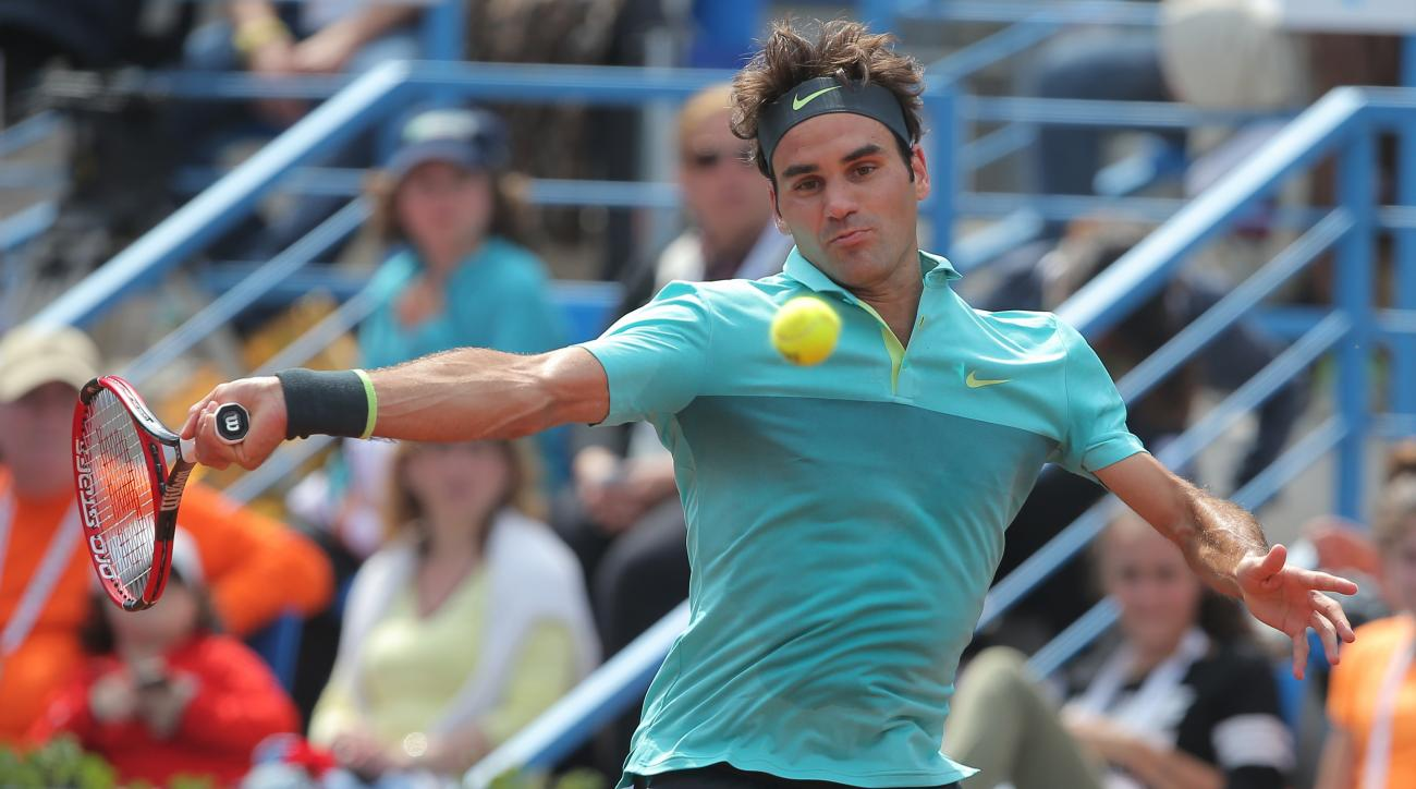 Roger Federer of Switzerland plays a return during a quarter final tennis match against Daniel Gimeno-Traver of Spain during the Istanbul Open tennis tournament at Garanti Koza Arena in Istanbul, Turkey, Friday, May 1, 2015. The first ever ATP World Tour