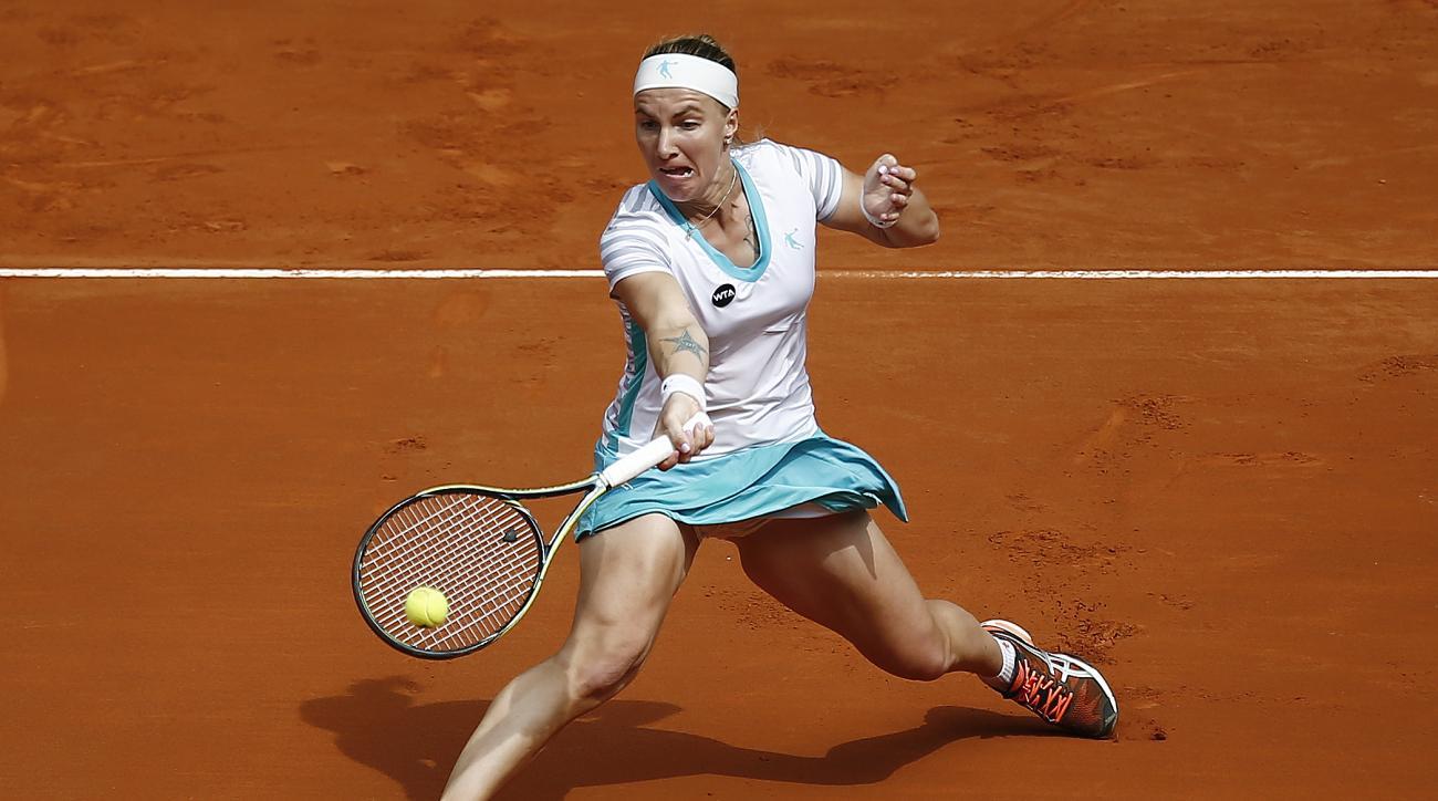 Svetlana Kuznetsova from Russia returns the ball during her Madrid Open tennis tournament match against Garbine Muguruza from Spain in Madrid, Spain, Monday, May 4, 2015. (AP Photo/Andres Kudacki)