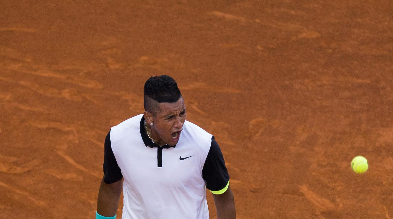 Nick Kyrgios from Australia celebrates winning a point during his Madrid Open tennis tournament match against Roger Federer from Switzerland  in Madrid, Spain, Wednesday, May 6, 2015. (AP Photo/Andres Kudacki)