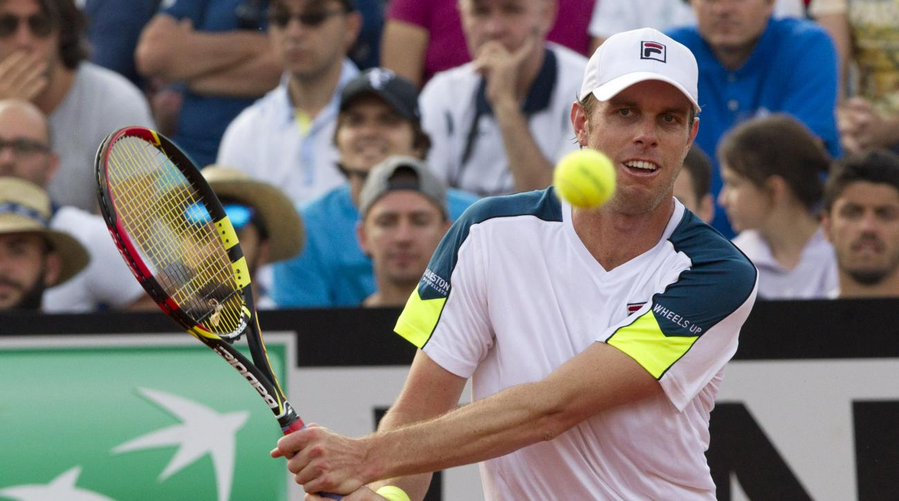 Sam Querrey of the US returns the ball to France's Jo-Wilfried Tsonga during their match at the Italian Open tennis tournament, in Rome, Tuesday, May 12, 2015. (AP Photo/Riccardo De Luca)