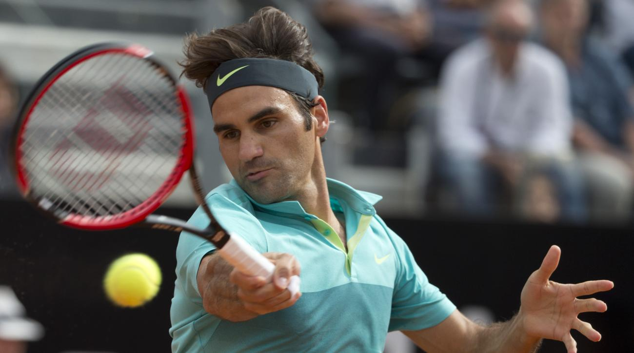 Roger Federer, of Switzerland, returnes the ball to Kevin Anderson, of South Africa, during their match at the Italian Open tennis tournament, in Rome, Thursday, May 14, 2015. (AP Photo/Andrew Medichini)