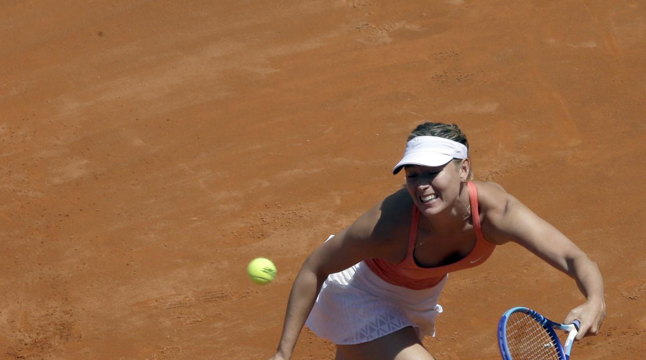 Maria Sharapova, of Russia, returns the ball to Carla Suarez Navarro, of Spain, during the final match of the Italian Open tennis tournament, in Rome, Sunday, May 17, 2015. (AP Photo/Alessandra Tarantino)