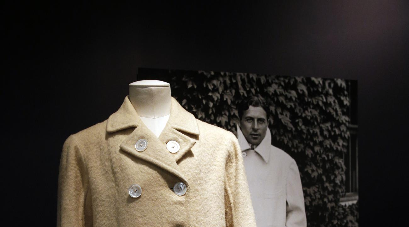 "In this photo taken Friday May 15, 2015, a tennis coat dating back to 1920 is displayed during an exhibition ""Game, Set, and Fashion"" at the Tennis museum of the Roland Garros Stadium, in Paris, France. The exhibit has more than 60 pieces of women's and m"