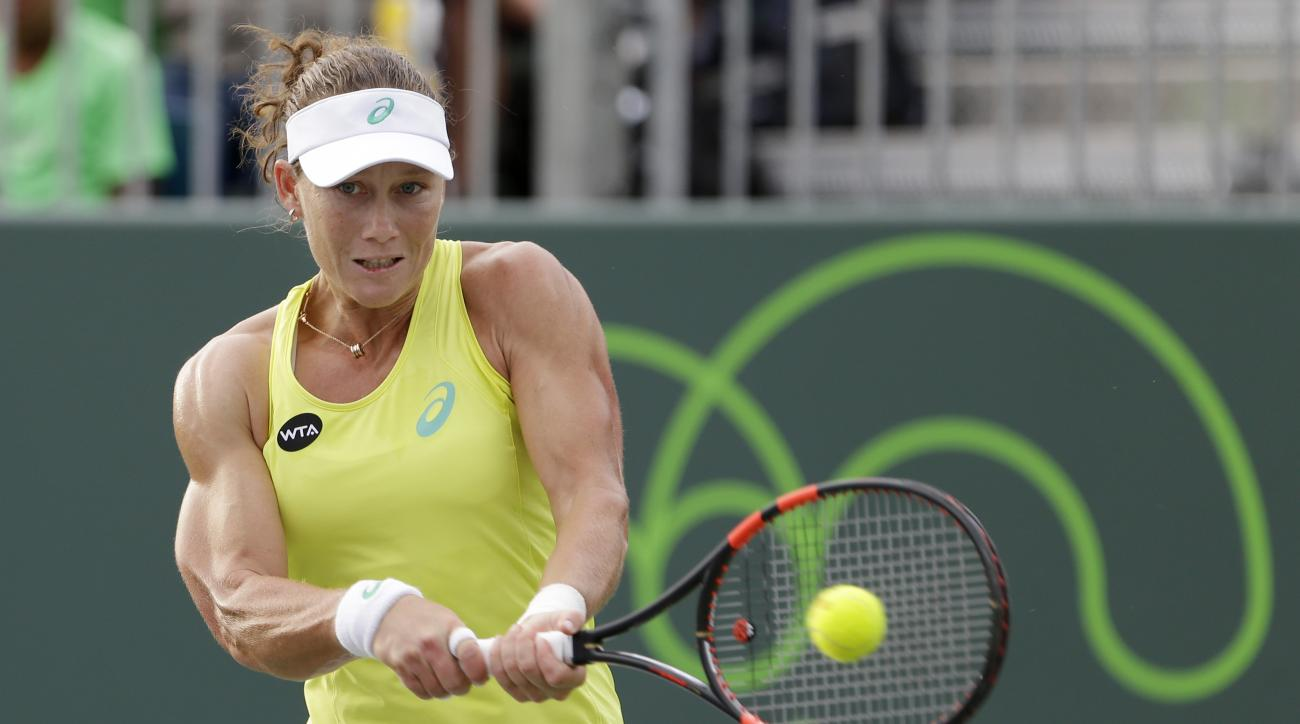 Samantha Stosur, of Australia, returns a shot from Venus Williams at the Miami Open tennis tournament, Saturday, March 28, 2015 in Key Biscayne, Fla. Williams won 6-4, 7-6 (3). (AP Photo/Wilfredo Lee)