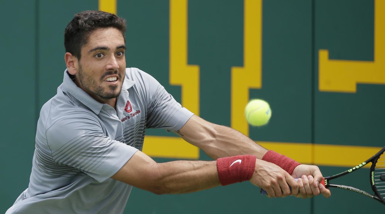 Oklahoma's Axel Alvarez returns a shot during the NCAA men's team tennis championships against Virginia, Tuesday, May 19, 2015, Waco, Texas. (AP Photo/LM Otero)