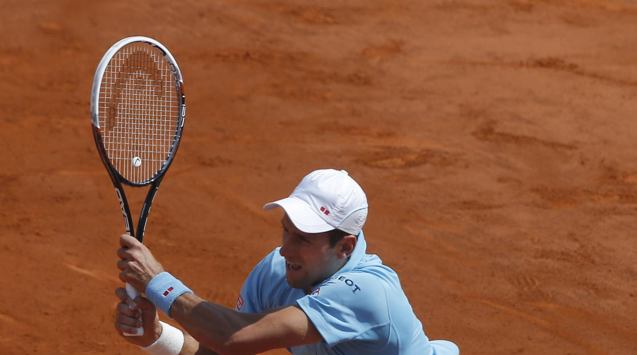 FILE - In this June 8, 2014, file photo, Serbia's Novak Djokovic returns the ball during the final of the French Open tennis tournament against Spain's Rafael Nadal in Paris, France. When the 2015 French Open begins, Rafael Nadal will not be the favorite,