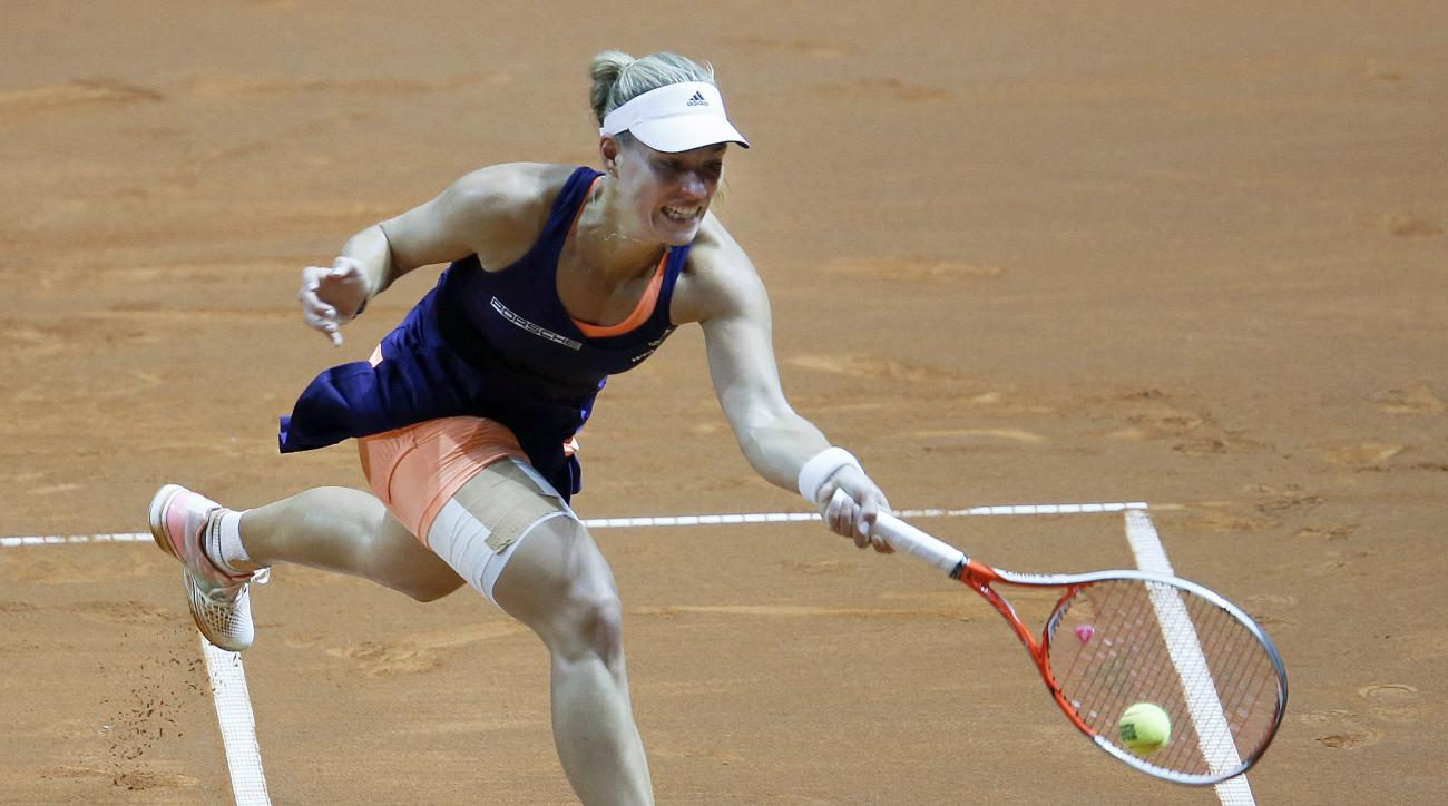Germany's Angelique Kerber hits a forehand against Denmark's Caroline Wozniacki in their final match at the Porsche Grand Prix tennis tournament in Stuttgart, Germany, Sunday, April 26, 2015. (AP Photo/Michael Probst)