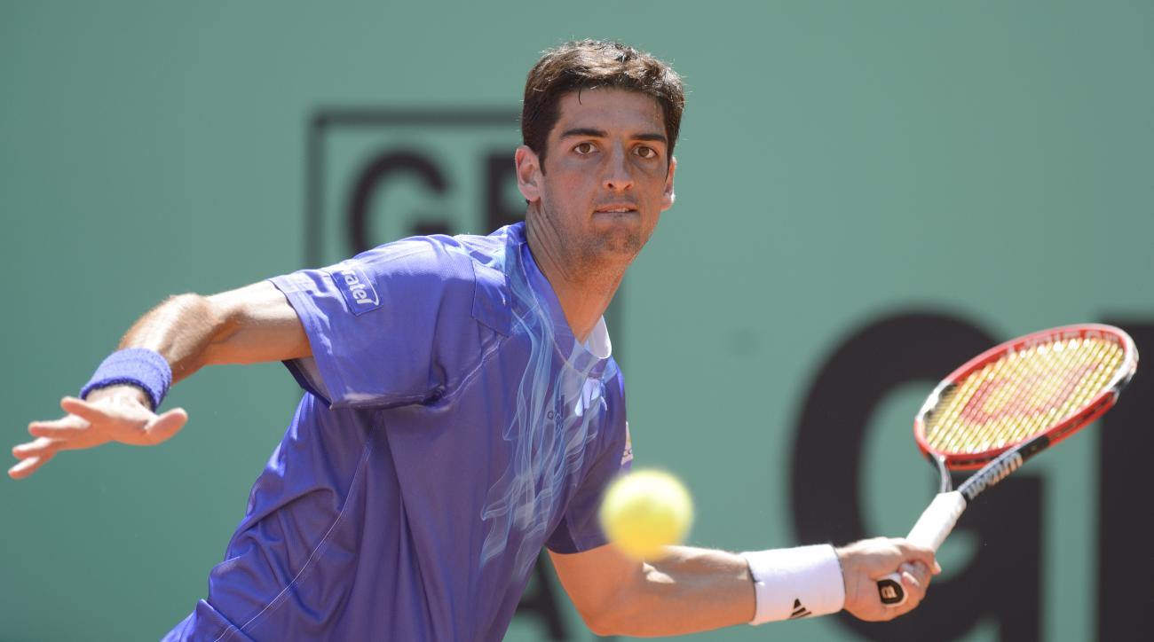 Thomaz Bellucci, of  Brazil, returns a ball to Santiago Giraldo of  Colombia, in their semifinal match during the Geneva Open tennis  tournament in Geneva, Switzerland, Friday, May 22, 2015.  (Martial Trezzini/Keystone via AP)