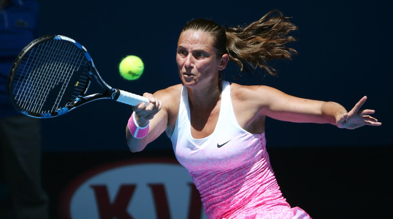 Roberta Vinci of Italy makes a forehand return to Ekaterina Makarova of Russia during their second round match at the Australian Open tennis championship in Melbourne, Australia, Wednesday, Jan. 21, 2015. (AP Photo/Rob Griffith)