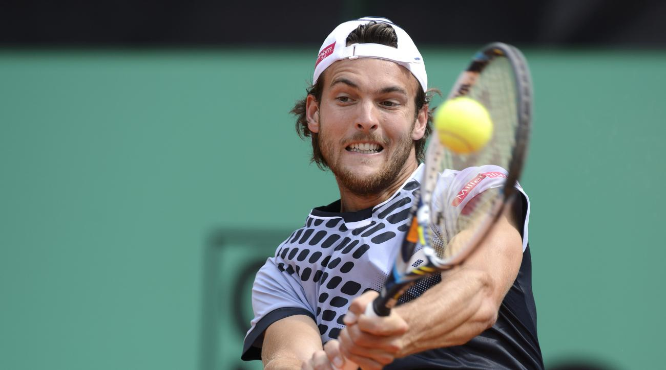 Joao Sousa of Portugal returns a ball to Thomaz Bellucci of Brazil, in their final match during the Geneva Open  tennis tournament in Geneva, Switzerland, Saturday, May 23, 2015.  (Martial Trezzini/Keystone via AP)