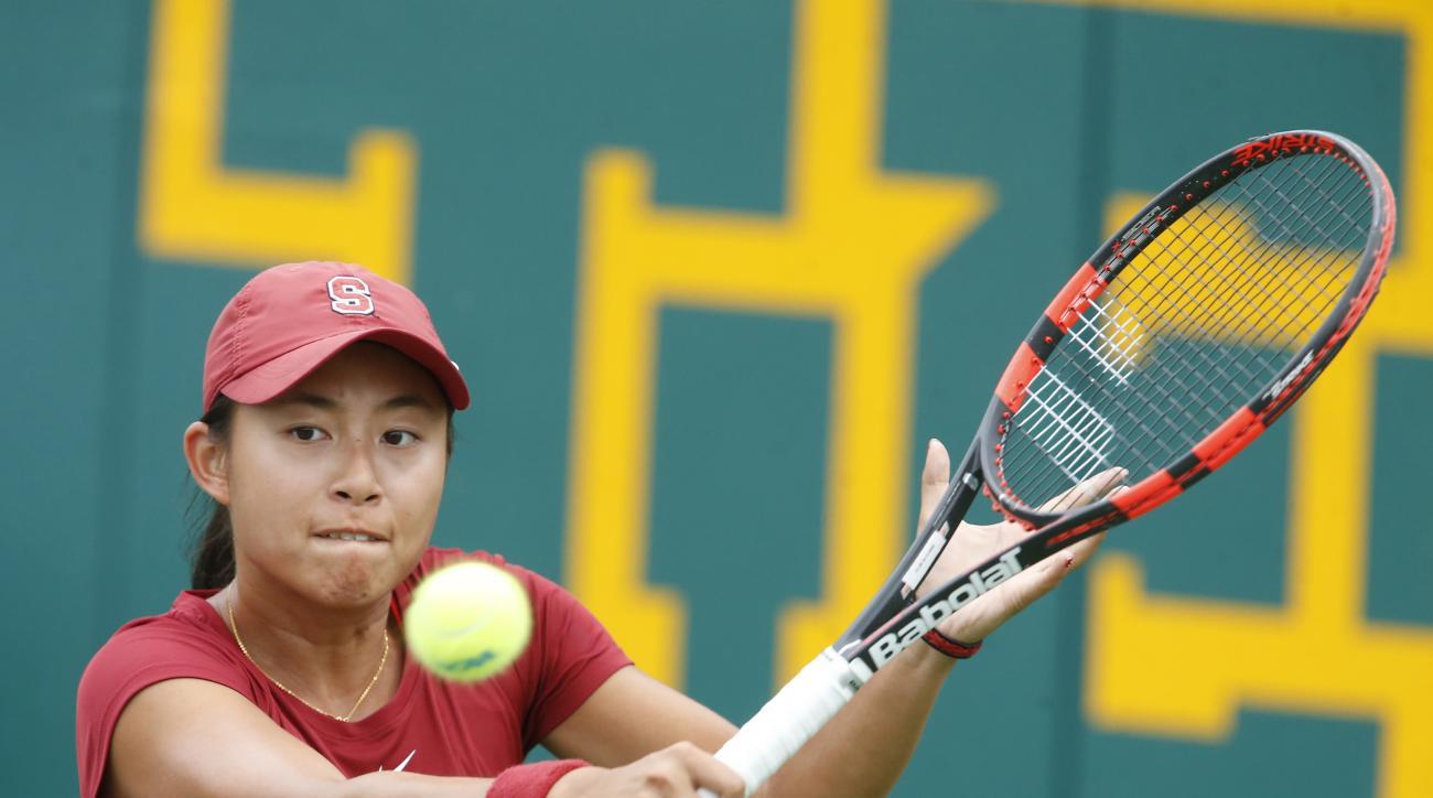 Stanford's Carol Zhao makes a return to North Carolina's  Jamie Loeb during the NCAA women's single tennis final Monday, May 25, 2015, in Waco, Texas. (AP Photo/Rod Aydelotte)