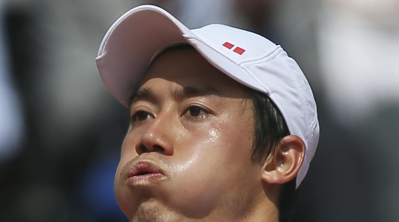 Japan's Kei Nishikori exhales as he celebrates winning the second round match of the French Open tennis tournament against Brazil's Thomaz Bellucci at the Roland Garros stadium, in Paris, France, Wednesday, May 27, 2015. Nishikori won in three sets 7-5, 6