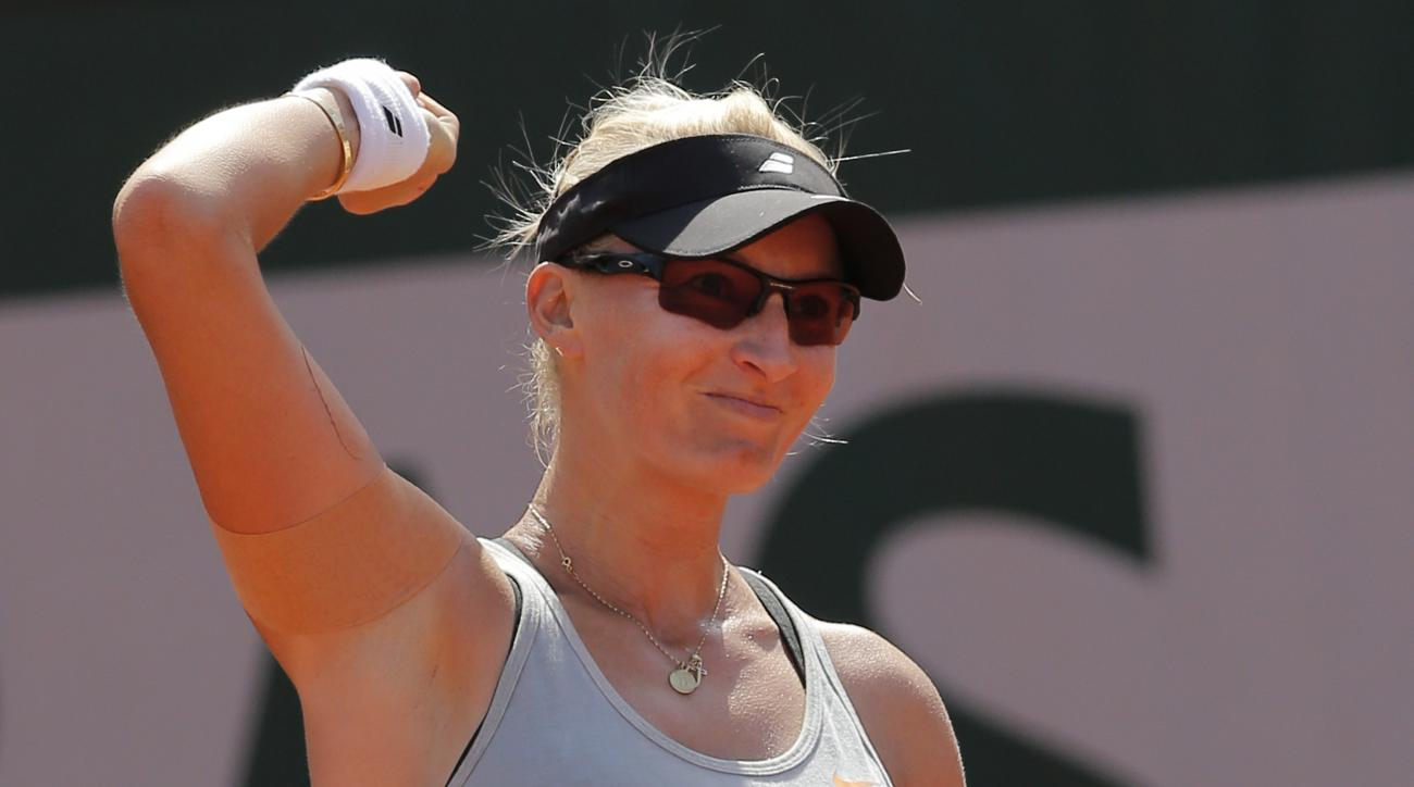 Croatia's Mirjana Lucic-Baroni celebrates winning the second round match of the French Open tennis tournament against Romania's Simona Halep at the Roland Garros stadium, in Paris, France, Wednesday, May 27, 2015. Lucic-Baroni won in two sets 7-5, 6-1. (A