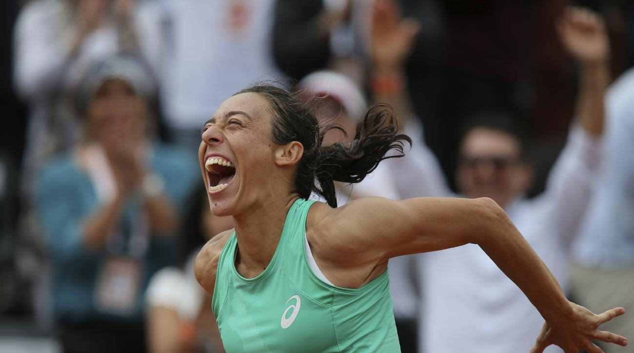 Italy's Francesca Schiavone celebrates after defeating Russia's Svetlana Kuznetsova during their second round match of the French Open tennis tournament at the Roland Garros stadium, Thursday, May 28, 2015 in Paris, . Schiavone won 6-7, 7-5, 10-8 in 3 hou