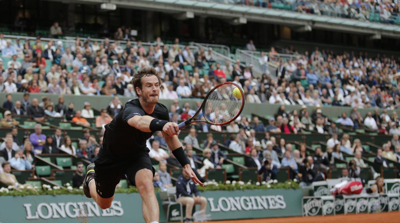 Britain's Andy Murray returns in the second round match of the French Open tennis tournament against Portugal's Joao Sousa at the Roland Garros stadium, in Paris, France, Thursday, May 28, 2015.  (AP Photo/Christophe Ena)