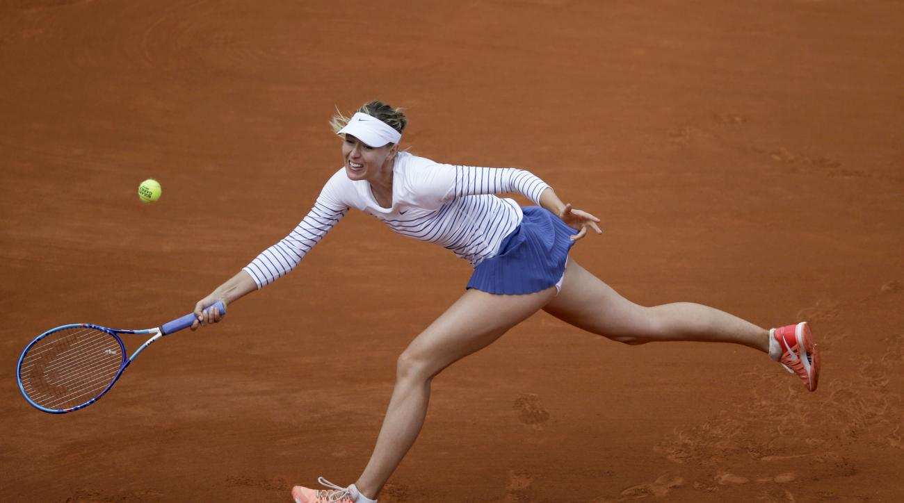 Russia's Maria Sharapova returns in the third round match of the French Open tennis tournament against Australia's Samantha Stosur at the Roland Garros stadium, in Paris, France, Friday, May 29, 2015. (AP Photo/Thibault Camus)