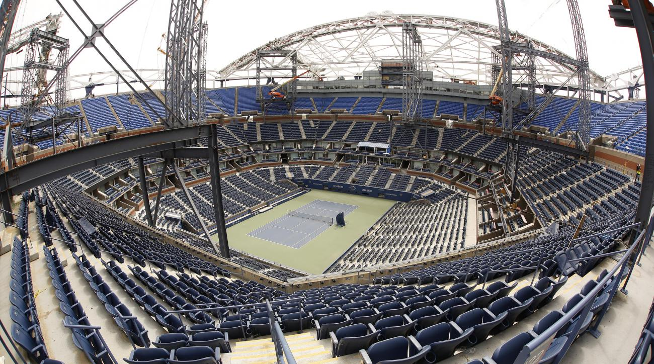 Construction on a roof over Arthur Ashe Stadium continues, Friday, May 1, 2015, at the USTA Billie Jean King Tennis Center in New York. While Wimbledon and the Australian Open already put retractable roofs over their main stadiums, players and fans at the