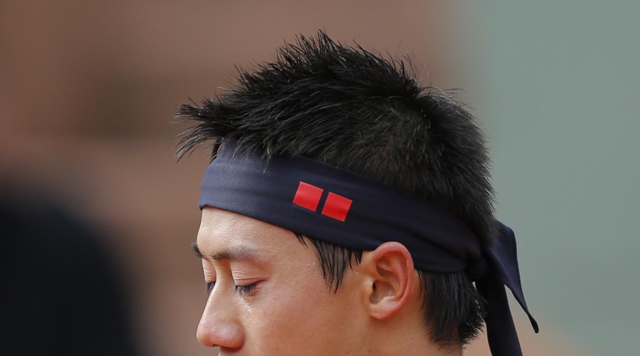 Japan's Kei Nishikori reacts as he plays Russia's Teymuraz Gabashvili during their fourth round match of the French Open tennis tournament at the Roland Garros stadium, Sunday, May 31, 2015 in Paris. Nishikori won 6-3, 6-4, 6-2. (AP Photo/Christophe Ena)