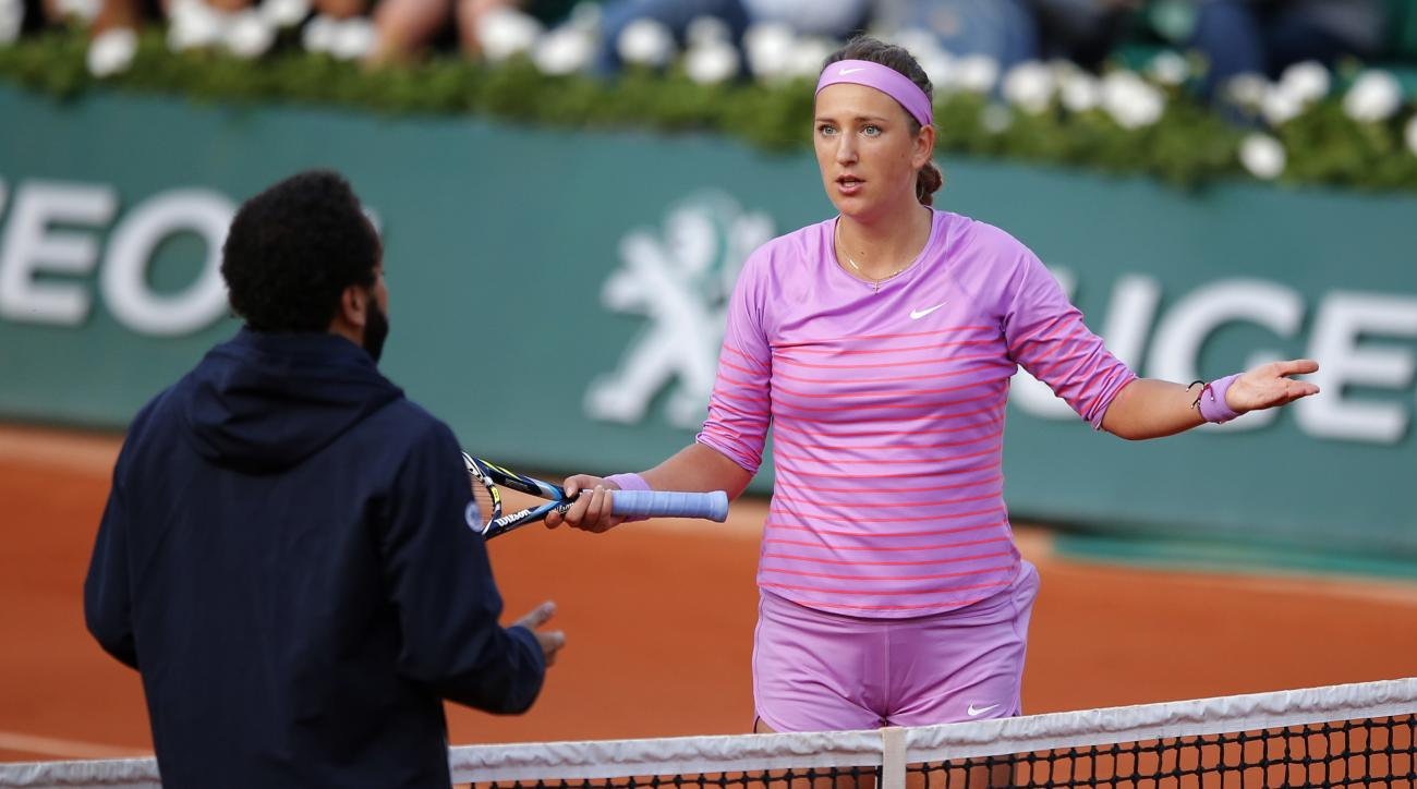In this picture taken Saturday May 30 2015, Belarus' Victoria Azarenka argues with chair umpire Kader Nouni during the third round match of the French Open tennis tournament against Serena Williams of the U.S. at the Roland Garros stadium in Paris, France