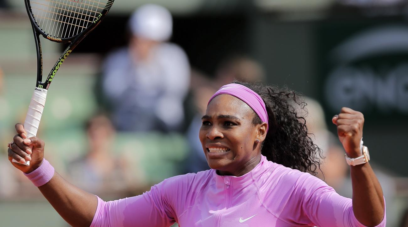 Serena Williams of the U.S. reacts as she defeats compatriot Sloane Stephens during their fourth round match of the French Open tennis tournament at the Roland Garros stadium, Monday, June 1, 2015 in Paris. Williams won 1-6, 7-5, 6-3. (AP Photo/Christophe