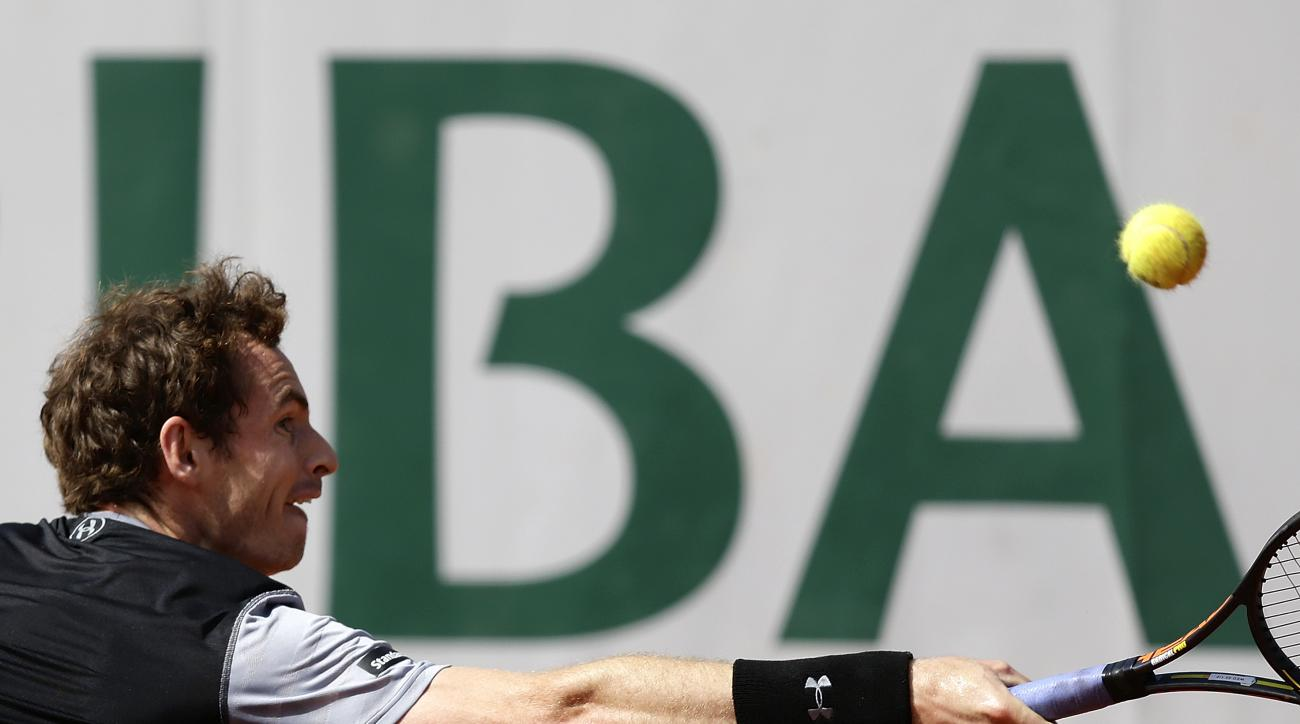 Britain's Andy Murray returns the ball to Spain's David Ferrer in after quarterfinal match of the French Open tennis tournament at the Roland Garros stadium, Wednesday, June 3, 2015 in Paris. Murray won 7-6 (4), 6-2, 5-7, 6-1. (AP Photo/Thibault Camus)