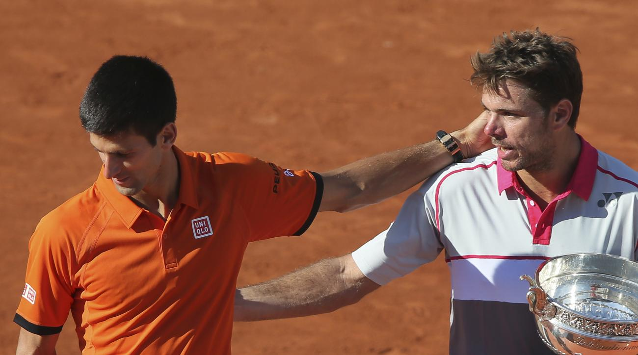 French Open winner Stan Wawrinka, right, looks at Serbia's Novak Djokovic as he leaves the podium after the men's final of the French Open tennis tournament at the Roland Garros stadium, in Paris, France, Sunday, June 7, 2015. Wawrinka won in in four sets