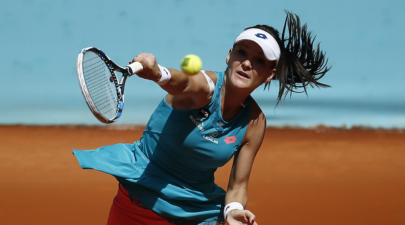 Agnieszka Radwanska from Poland serves during her Madrid Open tennis tournament match against Casey Dellacqua from Australia in Madrid, Spain, Monday, May 4, 2015. (AP Photo/Andres Kudacki)