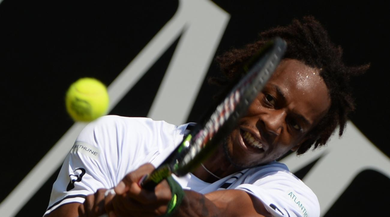 France's Gael Monfils  returns a shot  to Germany's Philipp  Kohlschreiber during his quarterfinal match at the  Mercedes Cup ATP  tennis tournament in Stuttgart, Germany, Friday June 12, 2015. (Marijan Murat/dpa, via AP)
