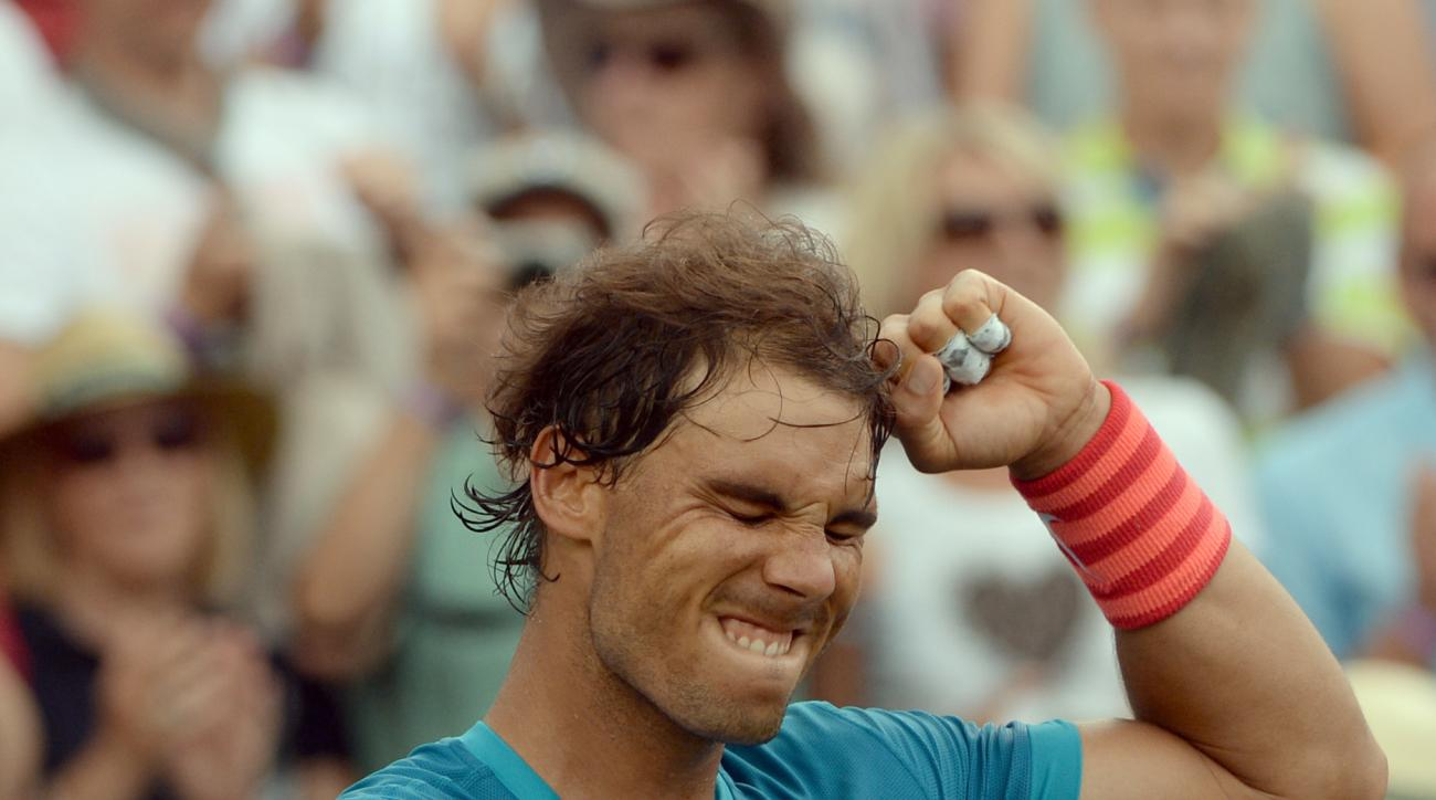 Spain's Rafael Nadal  celebrates  after he won the semifinal tennis match against Gael Monfils from France, at the ATP Mercedes Cup tennis tournament in Stuttgart, Germany, Saturday June 13, 2015. ( Marijan Murat/dpa, via AP)