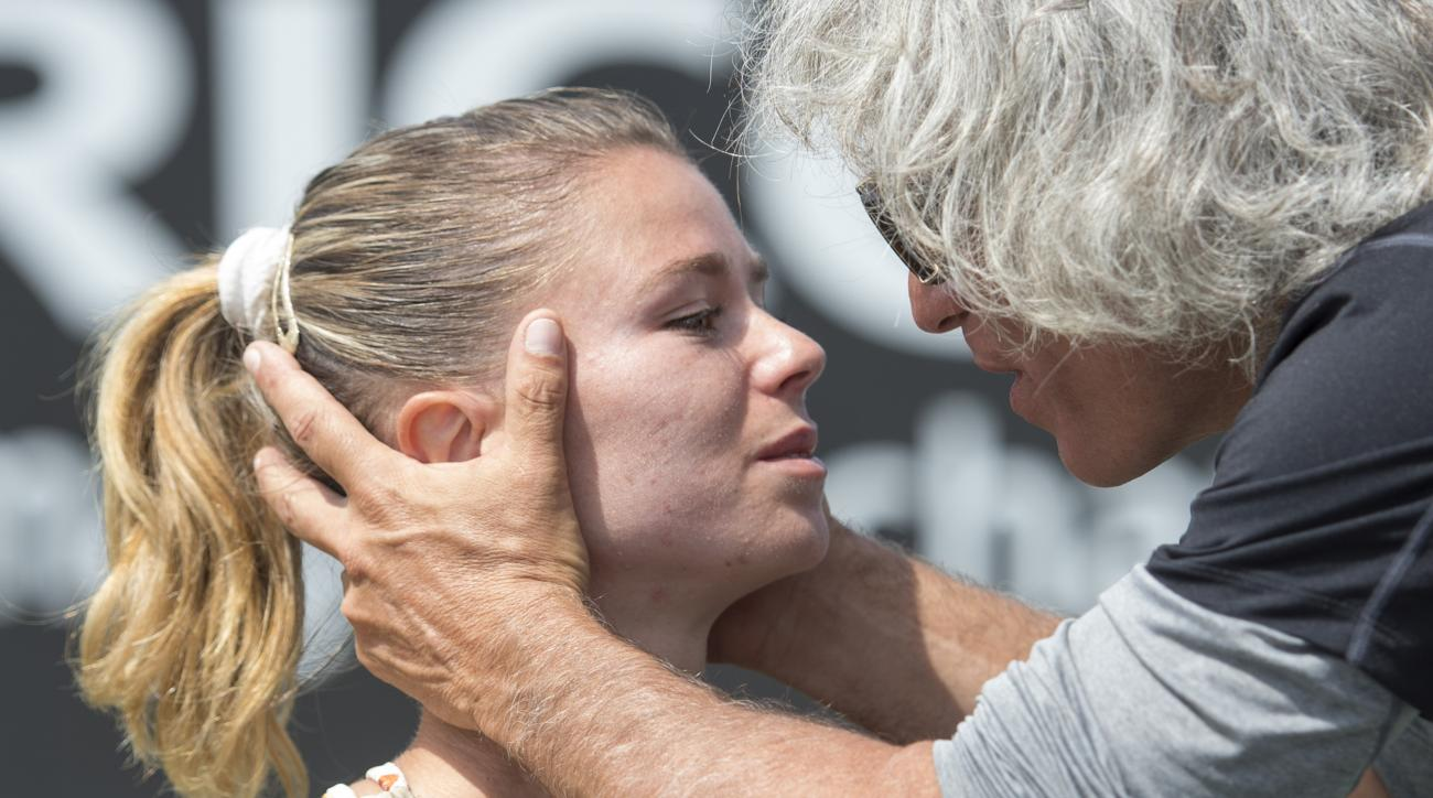 Camila Giorgi of  Italy is congratulated by her father Sergio Giorgi after winning  the women's final against Belinda Bencic of Switzerland,  at the open grass court tournament in Rosmalen, central Netherlands, Sunday, June 14, 2015. (AP Photo/Ermindo Arm